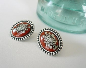 Red earrings. Studs. Red orange carnelian mid mod posts. Vintage orange cabs in new silver settings with sterling posts.