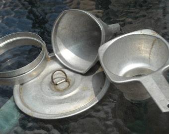 Assortment of vintage aluminum kitchen implements   Circa 1960s