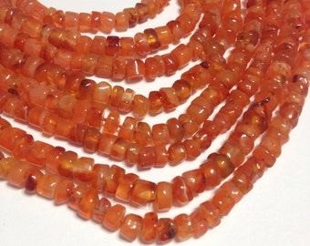 "Carnelian small heishi shaped stones full 14"" stand."