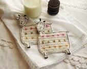 Crochet goat coasters, one pair