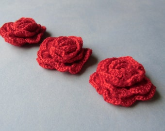3 red crochet roses for your craft.