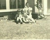 1930s Group of Kids Sitting Outside Holding Little Black Kitten Summer 30s Vintage Black and White Photo Photograph