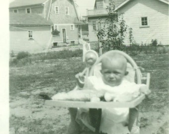 1930 Baby Sitting in High Chair Playing With Rattle Toy Back Yard Vintage Black White Photo Photograph
