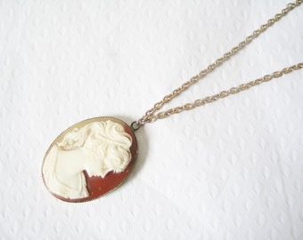 NEW YEAR SALE! Cameo gold pendant: Lovely oval gold tone and deep red cameo statement pendant necklace with long chain