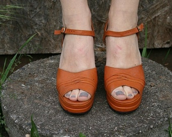 Studio 54, butterscotch colored wedges
