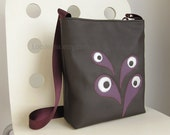 Messenger crossbody bag in dark chocolate vegan leather with purple strap and applique
