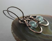 Copper dangle earrings with eye shaped hoops and wrapped pale blue aquamarine stones - Aquamarine earrings