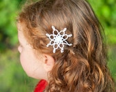 White tatted lace snowflake bobby pin. Hair accessory for snow queen or snow princess. Perfect for winter weddings, Christmas or holidays.