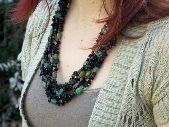 "black onyx, smokey quartz ""le fleur"" necklace with green glass and vintaj beads SALE"