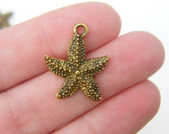 8 Starfish charms antique gold GC7