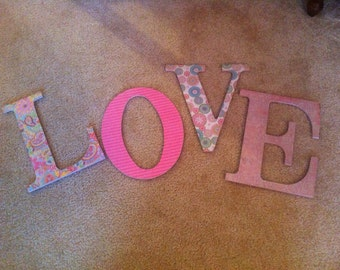 Paper covered wooden letters LOVE