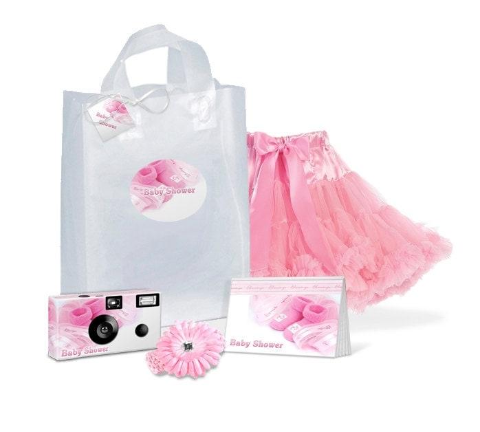 baby shower gift bag full of goodies camera photo album