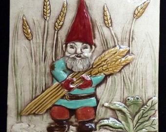 Decorative, relief carved ceramic gnome man tile