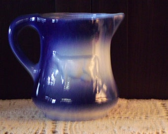 Blue and white cow pitcher