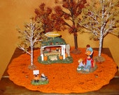 Use this orange doily to show off your fall, Halloween or Thanksgiving display
