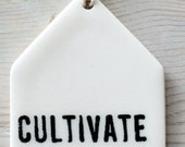 porcelain tag screenprinted text cultivate love.