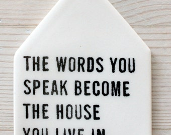 porcelain tag screenprinted text the words you speak become the house you live in. -hafiz