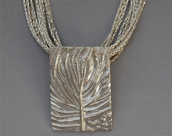 silver tree of life necklace, silver jewelry, made in america, hand carved, blowing in wind, ready to ship