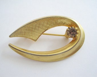 Vintage Gold Tone Curved Brooch with One Pale Lavender Rhinestone