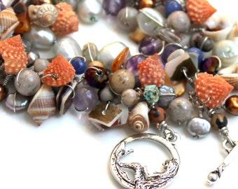 seascape bracelet / pearls / seashells / gemstones / peach / blue / tan / white / purple /