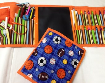Sports Art Tote complete with chalkboard, chalk, eraser, paper pad, pencil, crayons, and colored pencils