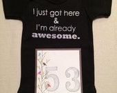 DISCOUNTED -- Nearly Perfect -- #53b, see photos -- I just got here & I'm already awesome.  -- black snapsuit, size 0-3 months