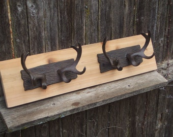 Rustic Cast Iron  Double  Deer Antler coat rack  -- lodge cabin decor -- rich patina on cast iron hooks and western cedar natural finish