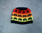 Wool hat: Space Invaders, black on red, orange, and yellow