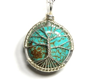 The Round Turquoise Tree of Life Necklace in Sterling Silver.