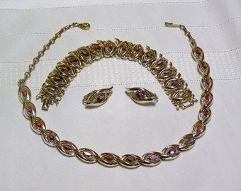 Vintage Coro Red Aurora Borealis..Marquis cut..rhinestones ...gold tone frames parute