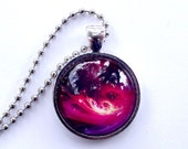 Shop closing Red swirling Sci  fi pendant. Planet necklace.. Antique Silver shiny  frame and chain.
