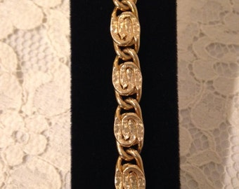 NICELY DETAILED BRACELET  -  Gold tone with texture and smooth finish - S Chain Bracelet