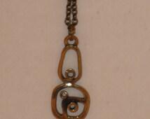 Small bronze pendant by PENTTI SARPANEVA Finland with original delicate chain