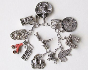 1960's Kinetic Sterling and other metal Charm Bracelet, charms from Germany, Mexico, Etc.
