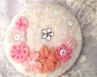 White and pink felt brooch with embroidery and embellishment