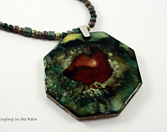 The Kiss Pendant, dark lucious lips in a sea of green mossy mass  MUAH No. 32