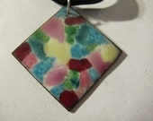 Enamel pendant necklace rainbow splatter pattern on black silk cord