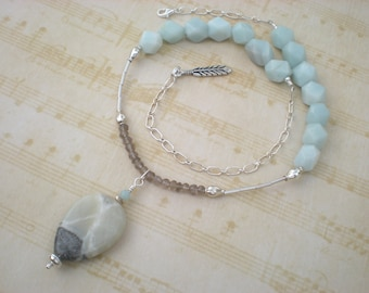 Crossed skies beaded necklace, amazonite, smoky quartz, sterling silver, feather charm, unique jewelry by Grey Girl Designs on Etsy