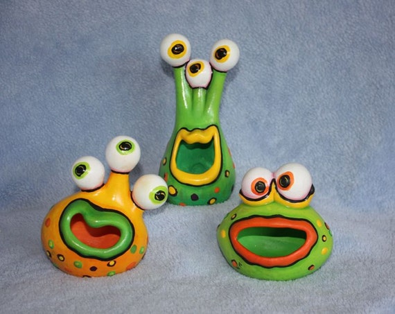 Handpainted ceramic Little Monsters set of three all colorfully painted in lime green, orange & yellow