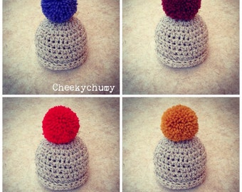 Oatmeal beanie hat with large bobble pom pom. You choose the colour. Size newborn. Great photo prop
