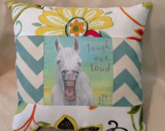 Laughing white horse quilted pillow