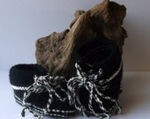 Hand knitted baby boys trainer style booties in black and white. 6 / 12 months.