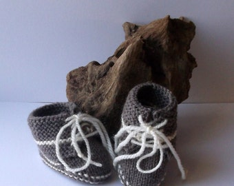Hand knit baby boys laced booties or trainer style shoes.  0 - 6 months. Light brown and cream.