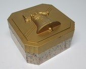 HICKOCK BOX with liberty bell in gold on the lid and base is an amusing speckled plastic .