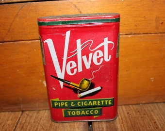 Velvet tin container with tobacco still inside