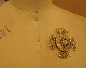 Gold baroque cross brooch