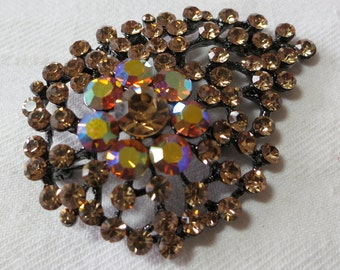 """Vintage pin, brooch, costume jewelry, Amber toned stones, Paisley shape, open work, safety clasp, 2.5""""  long, 2"""" ins wide. UNK13.11-11.24"""