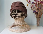 Stylish 1920s-style checked fabric hat.