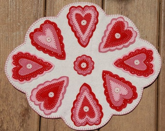 Layers of my Hearts Penny Wool Candle Mat.