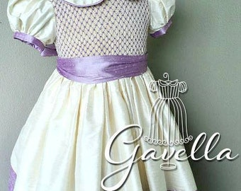 Girls custom FULLY smocked bodice, silk dupioni dress with band trimmed sleeves and solid hem. Free matching bow. Two colors of your choice.